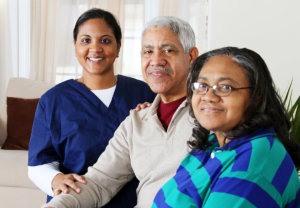 a caregiver woman with an elderly couple