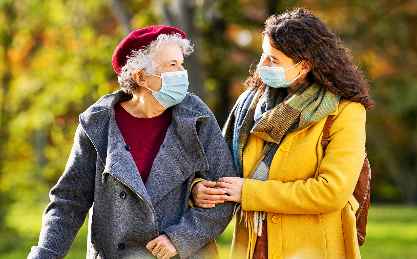 two people wearing surgical mask