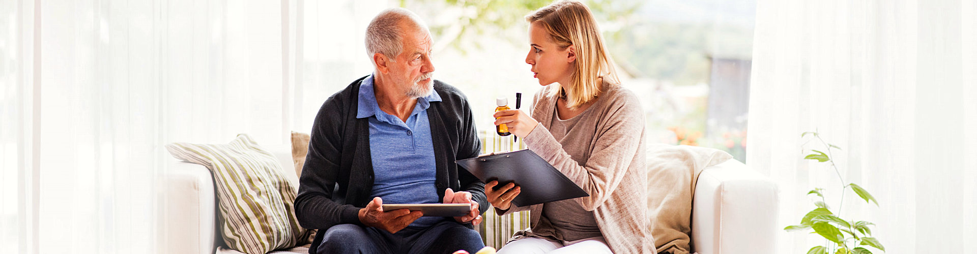senior man having a discussion with his caregiver