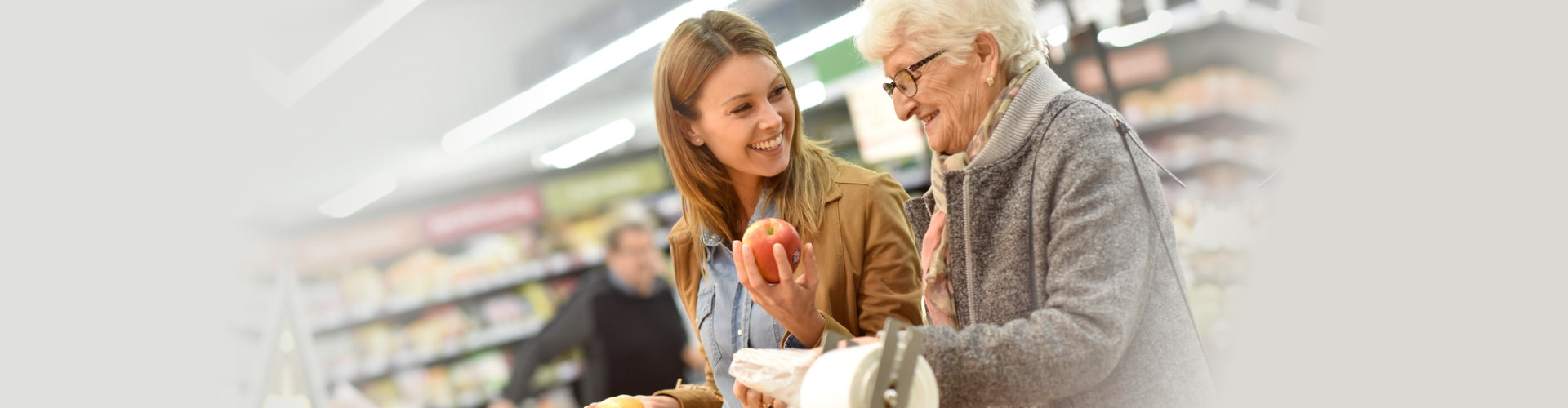 senior woman going grocery with her caregiver