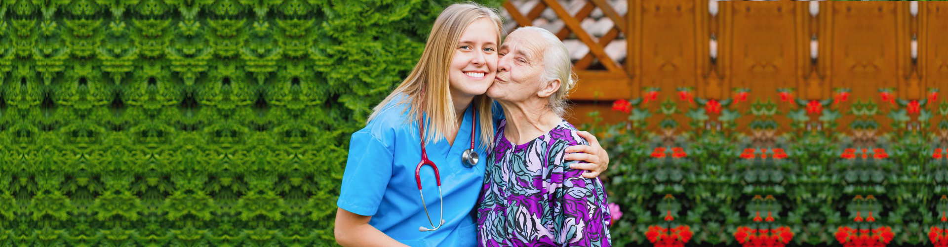 an elderly woman kissing a caregiver woman in the cheeks